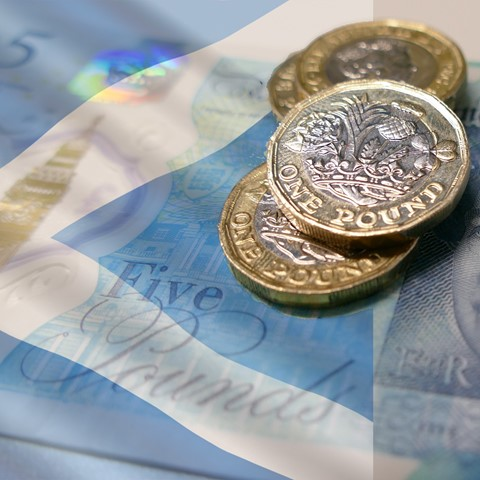 coins and banknote with Scotland flag