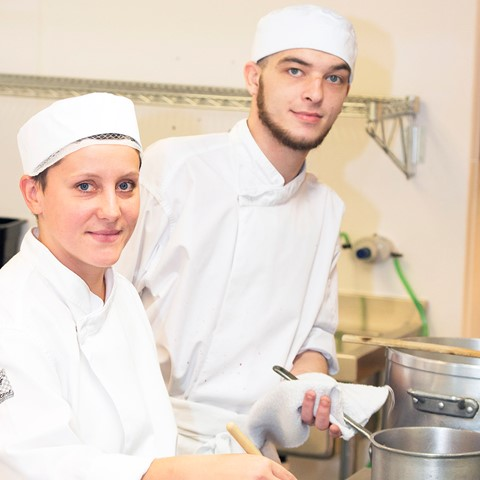 cookery students in kitchen