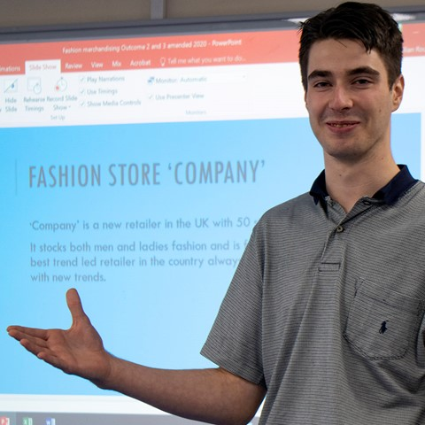student giving fashion presentation