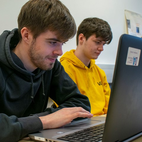students working at laptop