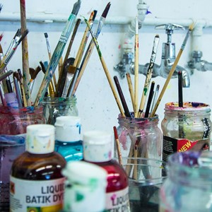 paints, brushes and jars of water
