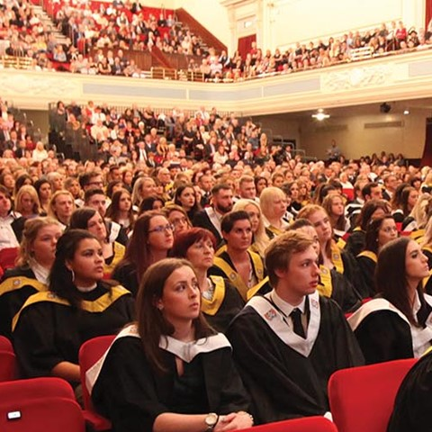 Graduating students seated in Caird Hall