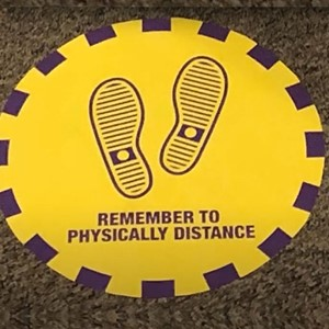 Remember to physically distance sign
