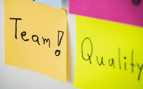 colourful post it notes with team and quality written on them